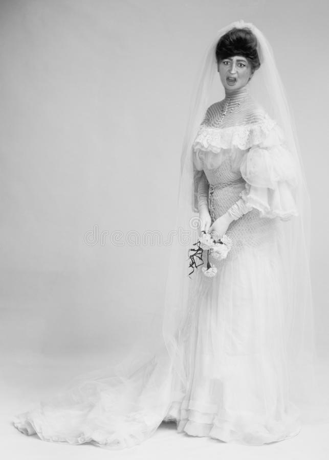 Funny Vintage Bride, Marriage, Woman. Funny vintage retro bride. The woman has a scared and frightened look on her face. Marriage can be full of fright stock photo