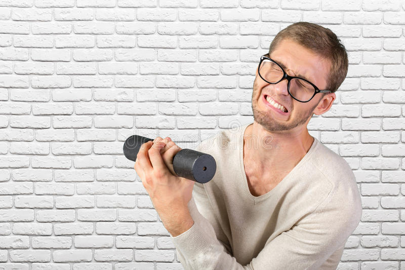 Funny weak man stock photography