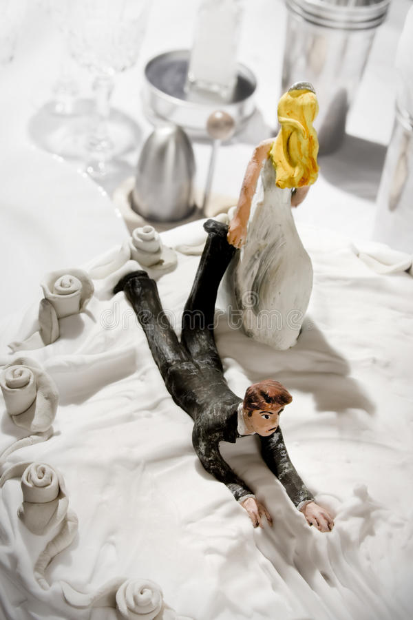 Funny wedding cake figurines stock image