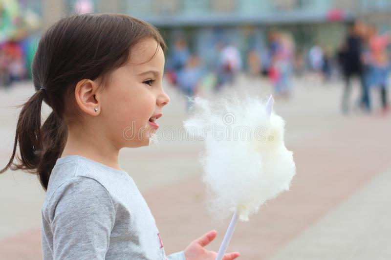 funny white girl with pigtails with cotton candy in hand on a city holiday royalty free stock photos