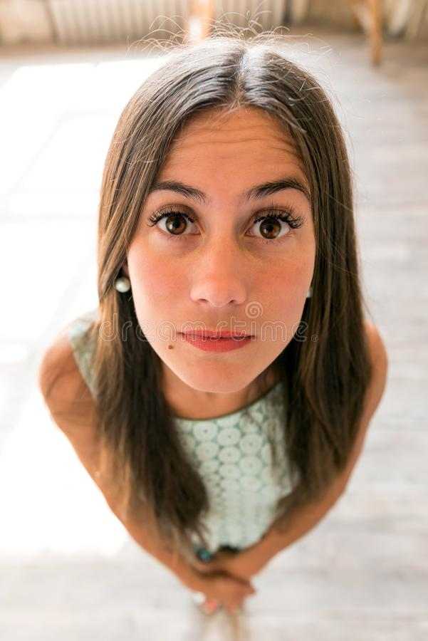 Funny wide angle close-up portrait of a cute woman royalty free stock photo