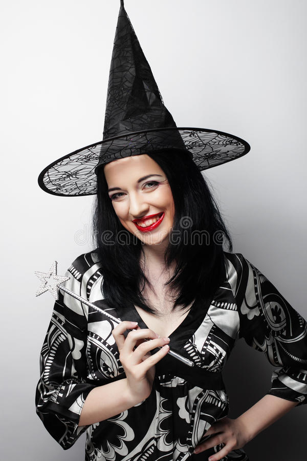 Funny Witch. Young happy woman with canival hat. royalty free stock photo