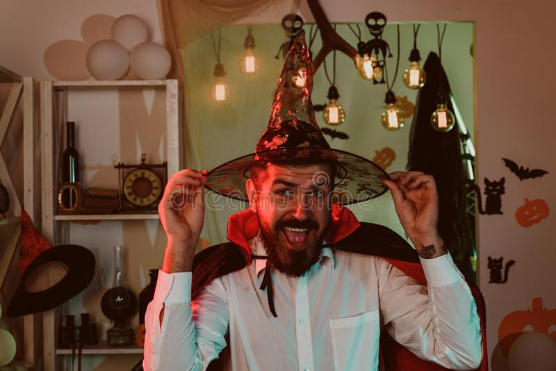 Funny wizard. Happy man on Halloween. The animator at the party. A man in a wizard costume. New Year. Christmas. Mens. Mood for the holiday stock image