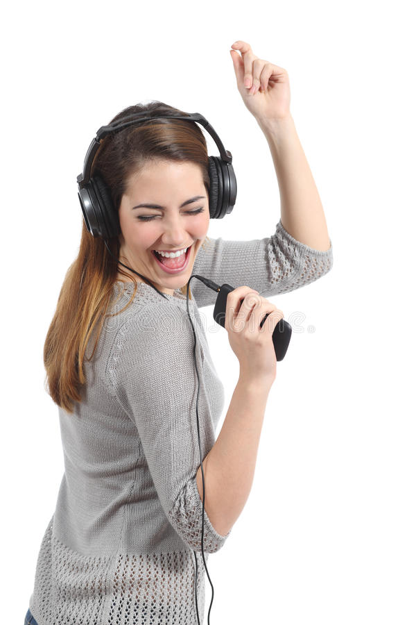 Funny woman dancing and listening to the music stock photo