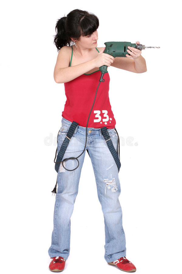 Funny woman with a drill stock photo