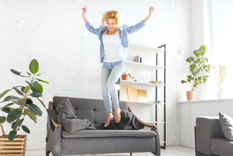 amusing nice living room stock photography image 18909472   Young Woman Jumping On Couch Stock Photo - Image of female ...