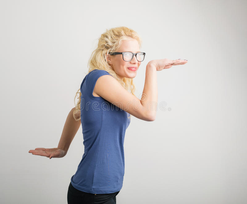 Funny woman making funny moves royalty free stock photos