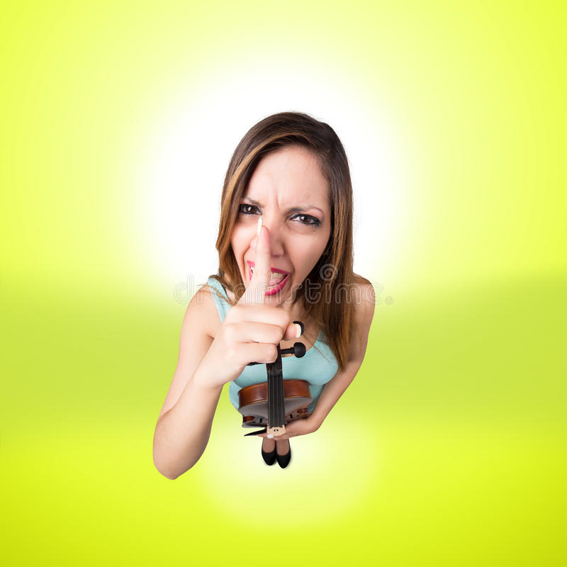 Funny woman with violin say shut up. Funny angry woman with violin say shut up royalty free stock photos