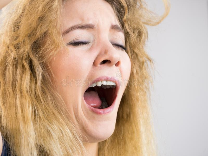 Funny woman yawning. Face close up of funny woman yawing with wide open mouth. Sleeping problem, morning tiredness stock images