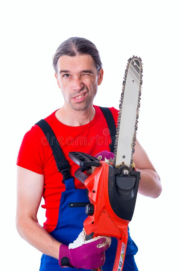 Funny worker with chainsaw. In front of white background stock photos