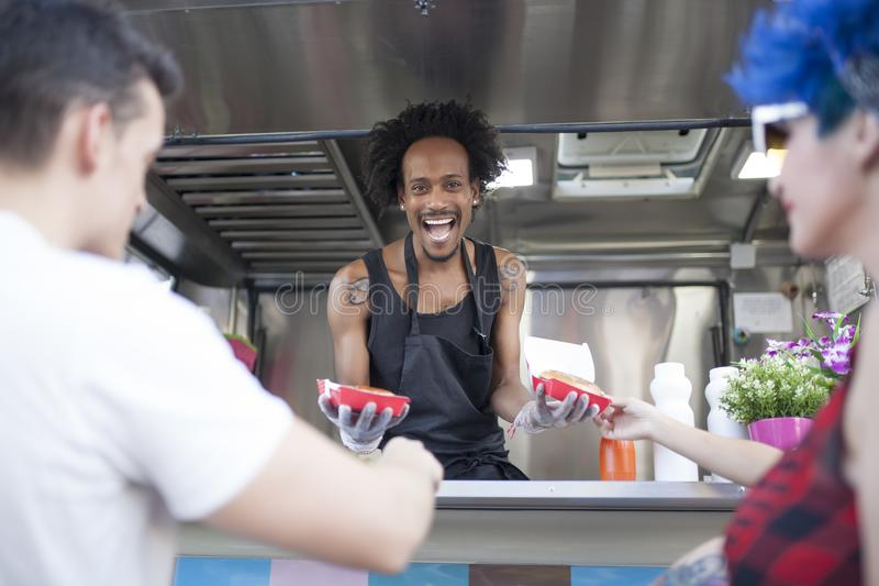 Two people works in a Food truck stock photos
