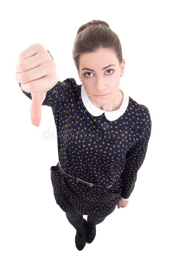 Funny young beautiful business woman in black dress thumbs down stock photo