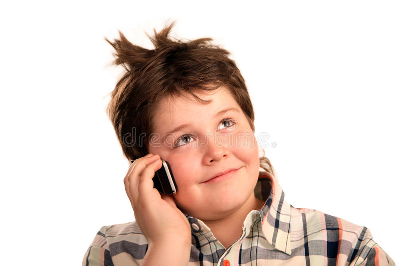 Funny young boy talking on the phone stock images