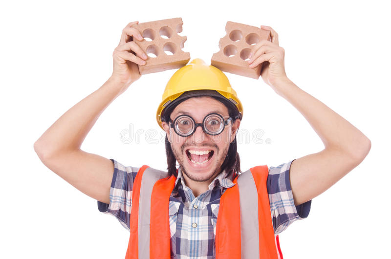 Funny young construction worker with broken brick. On white royalty free stock photo