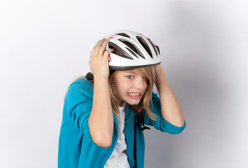 Funny young girl wearing helmet royalty free stock photos