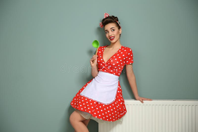 Funny young housewife with ladle royalty free stock photography