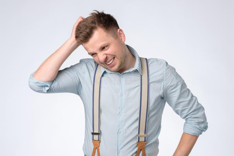 Funny young man hold his head in hand forgotten something stock photos
