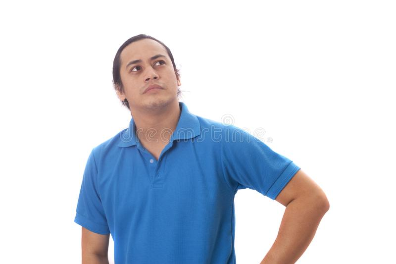 Funny Young Man Thinking Expression, Looking to The Side. Young Asian man wearing casual blue shirt thinking, looking to the side. Close up body portrait stock images