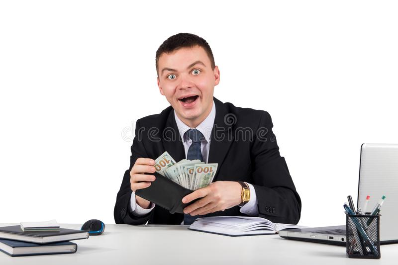 Funny young screaming successful caucasian businessman in black suit holding money stock photo