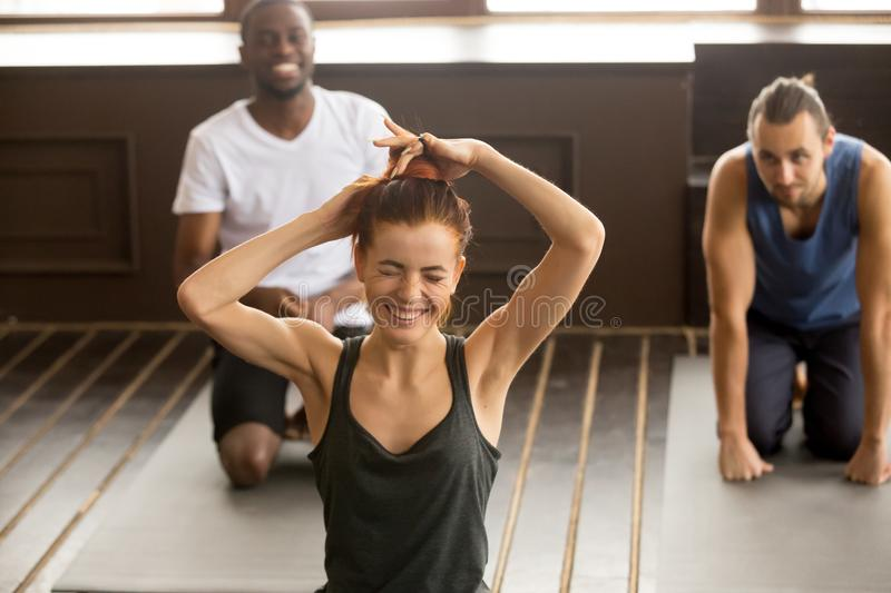 Funny young woman laughing at multi-ethnic group fitness yoga cl royalty free stock image