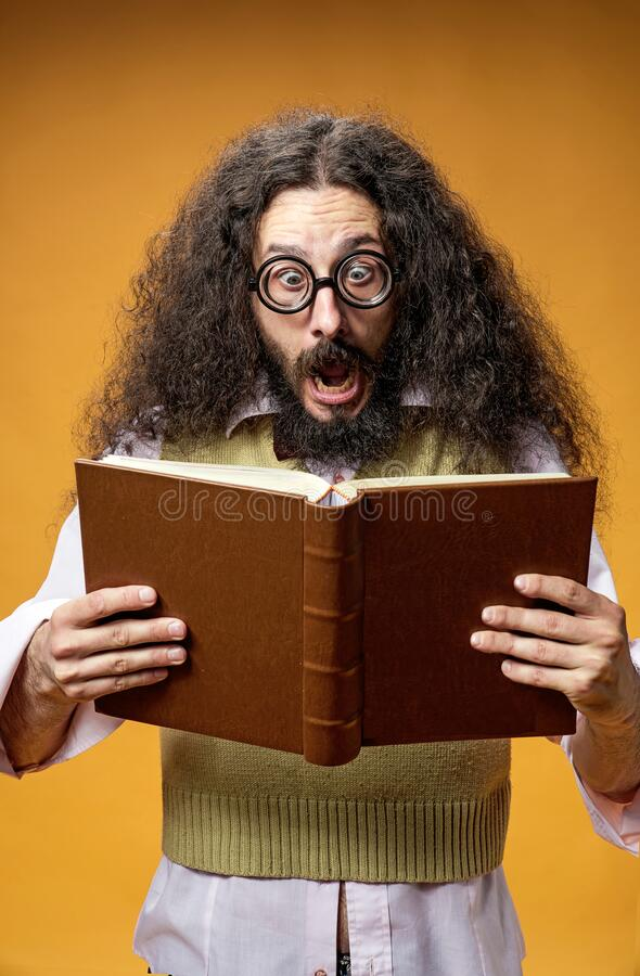 Funy nerd surprised of a book content royalty free stock photography