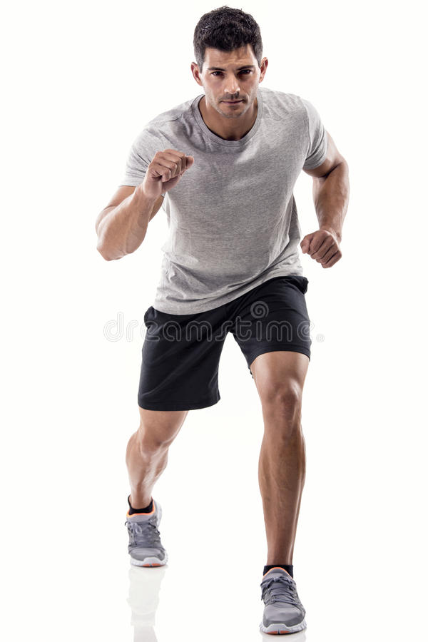 Funzionamento atletico dell'uomo fotografia stock