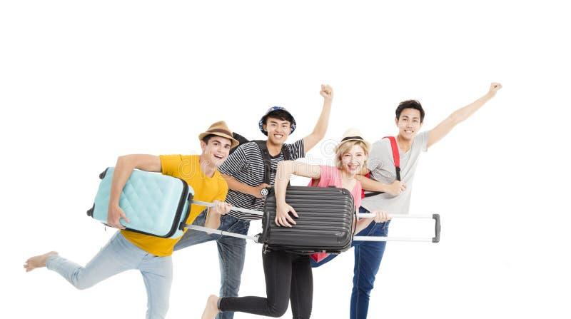 Funzionamento del gruppo e vacanza giovani godere fotografia stock