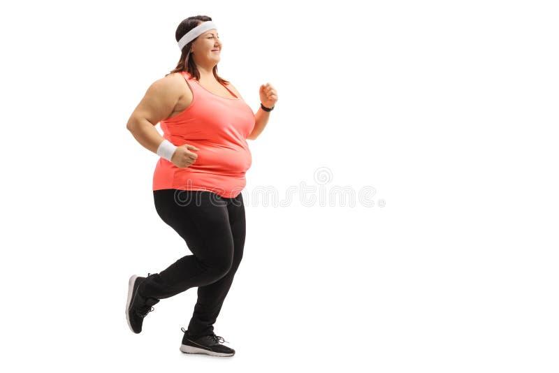 Funzionamento di peso eccessivo della ragazza immagini stock