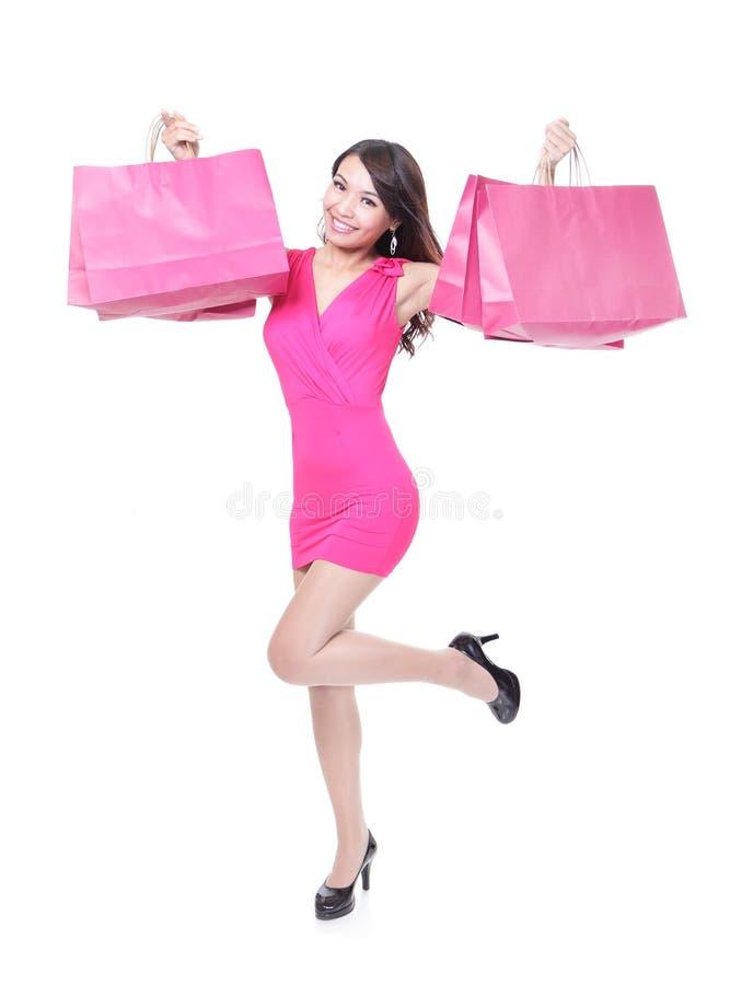 Funzionamento felice della giovane donna di acquisto immagine stock libera da diritti