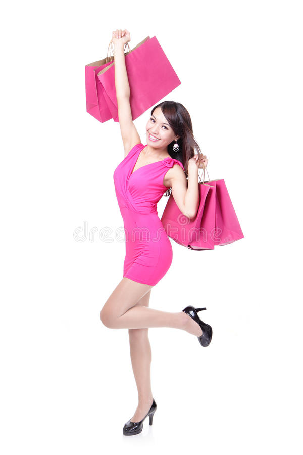 Funzionamento felice della giovane donna di acquisto immagini stock libere da diritti