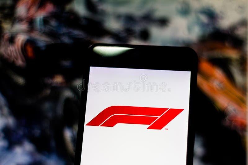 Funzionario F1 FIA Formula 1 logo sullo schermo del dispositivo mobile Campionato del mondo del logotype dell'icona di logo F1 Gr fotografia stock libera da diritti