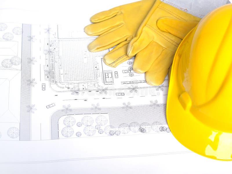 Funzioni il casco e i glowes del cappello duro dell'elmetto protettivo della strumentazione immagine stock