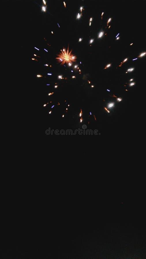 Fuochi d'artificio blu ed arancio fotografia stock libera da diritti