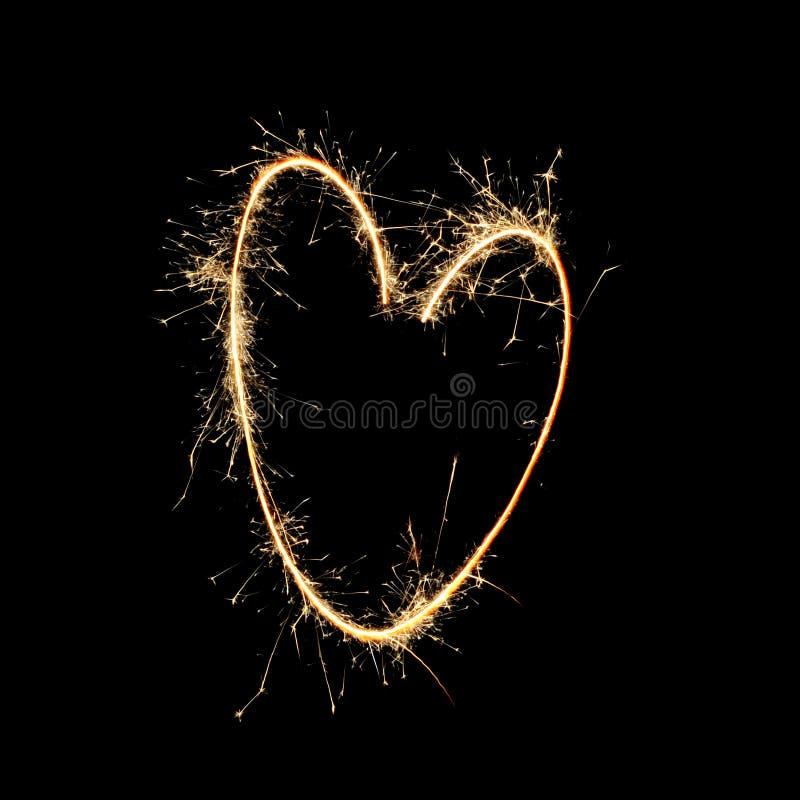 Fuochi d'artificio: Cuore dalla fiamma fotografia stock