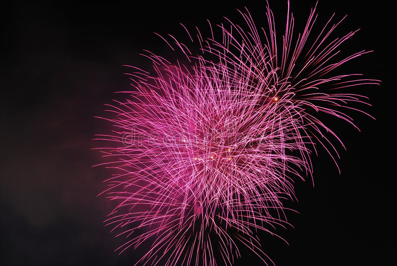 Fuochi d'artificio indicando celebrazione e successo fotografie stock