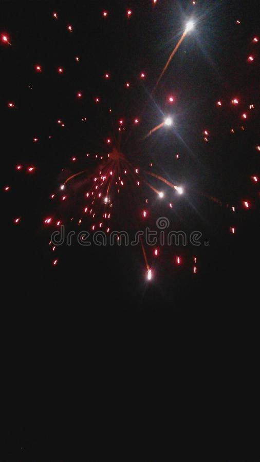 Fuochi d'artificio rossi in fotografia stock