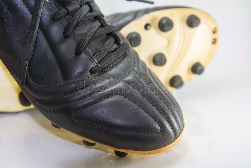 Fuoco selettivo al bottone delle scarpe di calcio immagine stock
