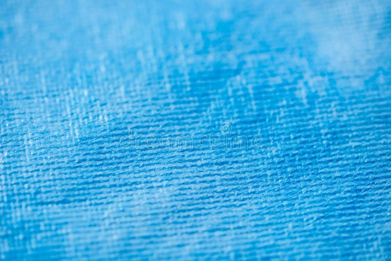 Fuoco selettivo della tela di macro struttura aristic blu del fondo immagini stock