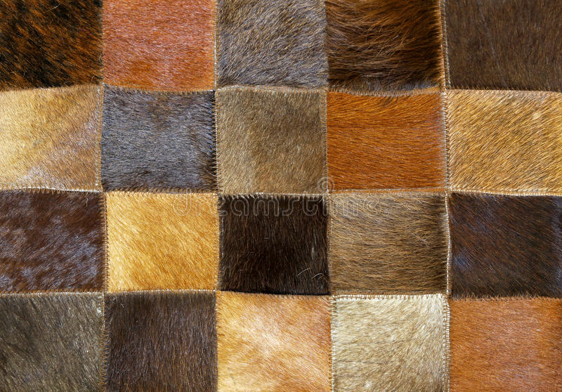 Fur. Brown animal fur made from patches and parts royalty free stock photos
