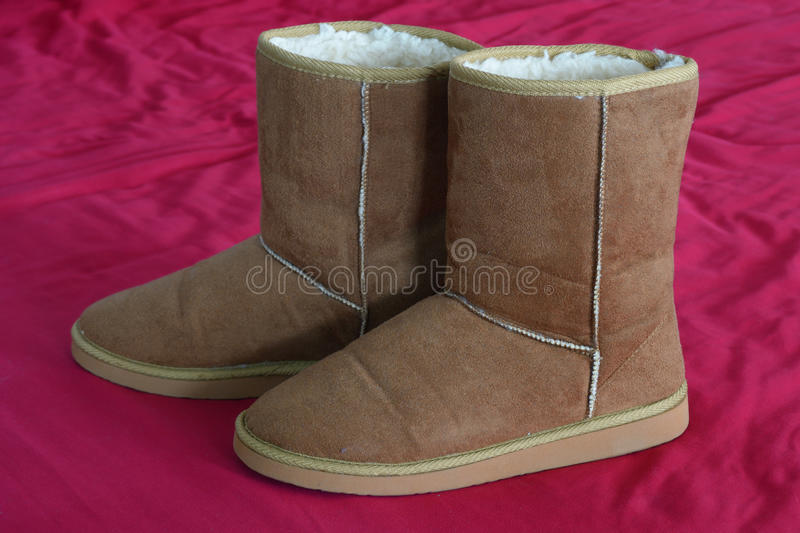 Fur Boots. Leather tan boots with the fur royalty free stock photography