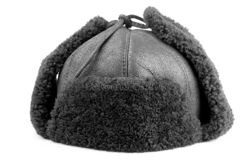 Fur cap for winter. On a white background royalty free stock images
