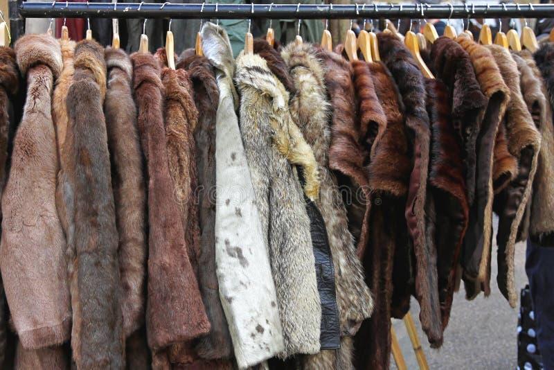 Fur coats. Various animal fur coats at hangers stock images