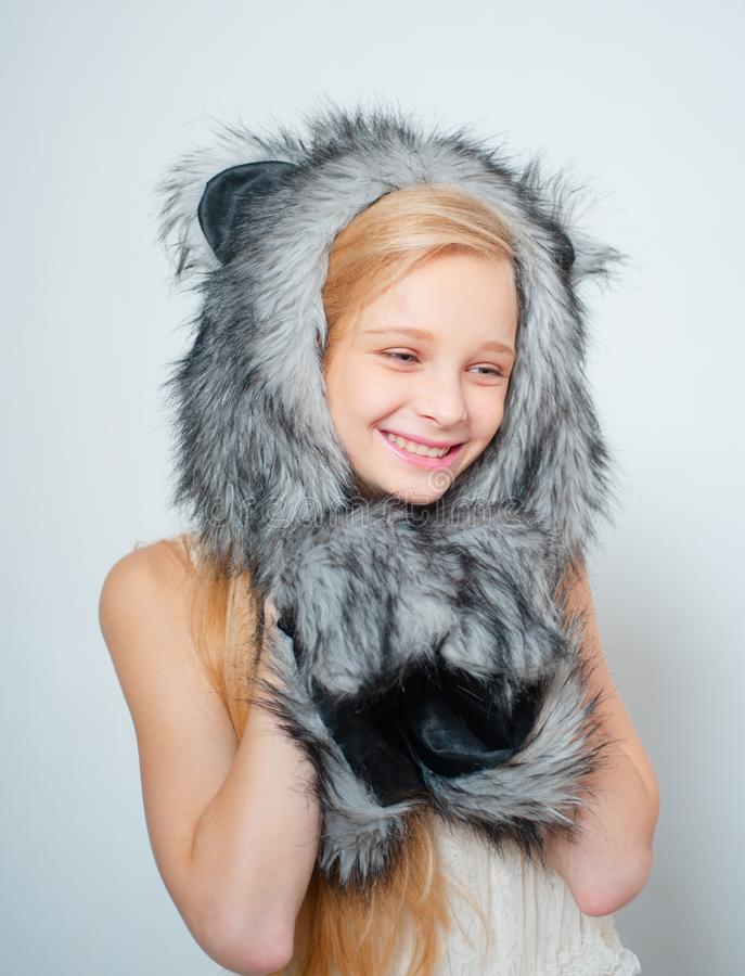 Fur Fashion. Small fashionista. Small girl wear winter hat scarf. Happy child smile in fashion style. Winter fashion. Trends for kids. Cosy accessory for chilly royalty free stock photos
