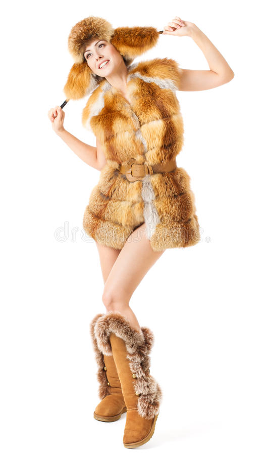 Fur fashion woman in coat, hat and boots. Over white. Happy smiling posing girl stock photo