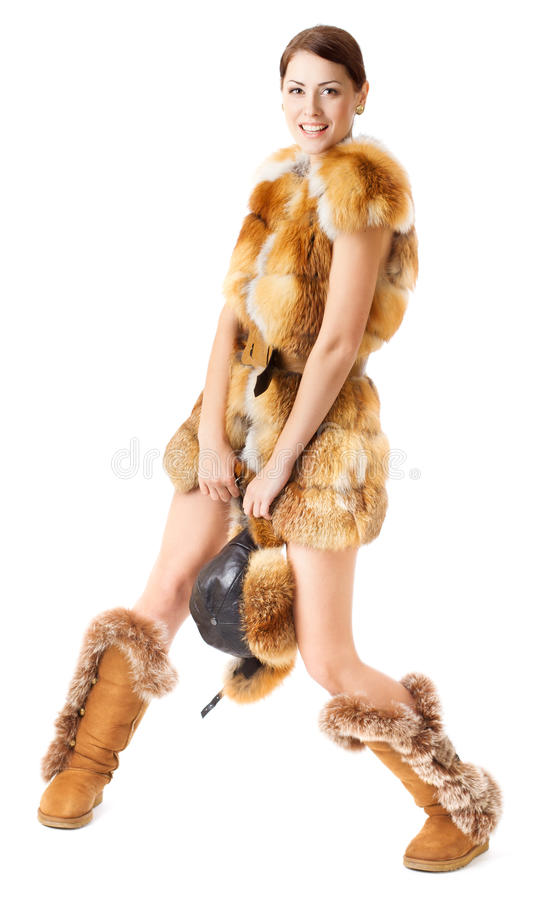 Fur fashion woman: coat, hat and boots over white. Happy smiling girl stock images