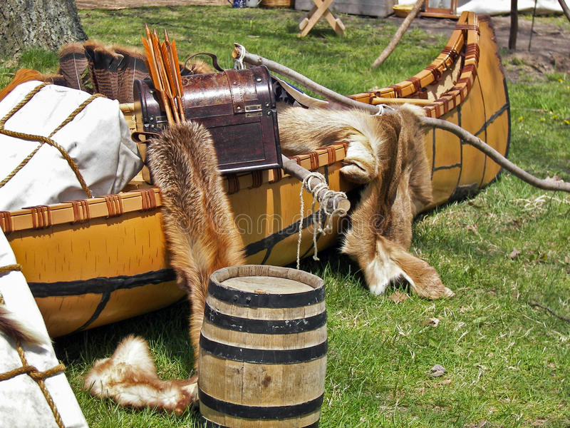 Fur pelts with Indian canoe. Fur pelts and trunk in Indian canoe royalty free stock photos