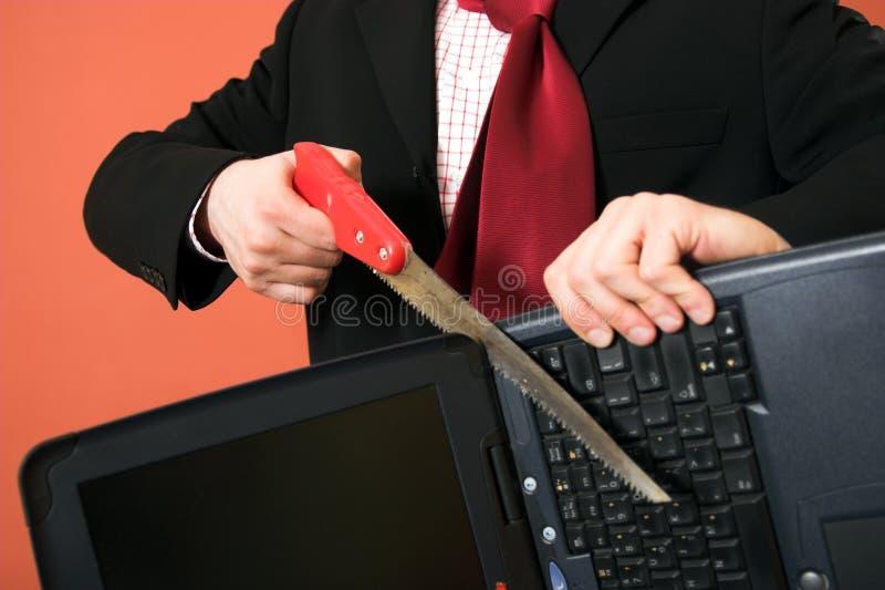 Fureur contre l'ordinateur portatif photographie stock