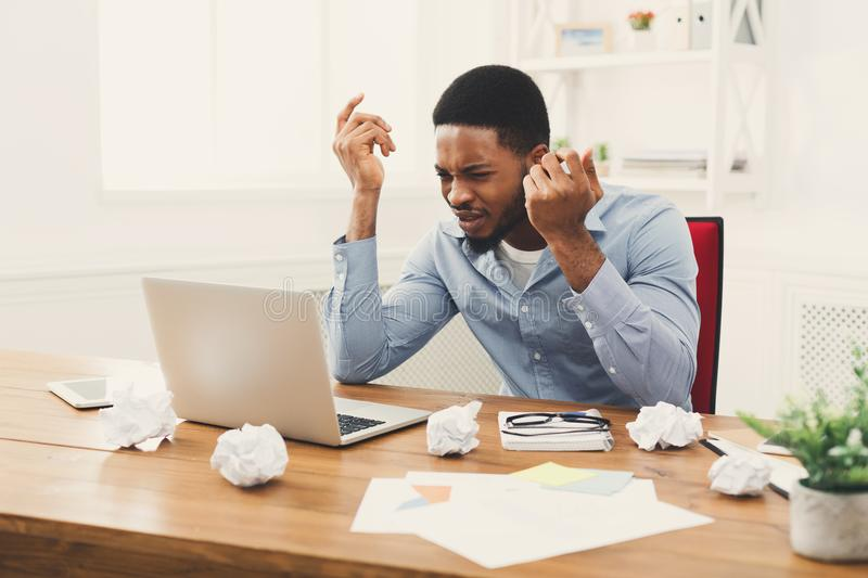 Furious african-american employee at workplace stock images