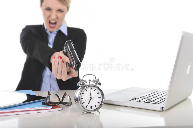 Furious angry businesswoman working pointing gun to alarm clock in out of time concept royalty free stock images