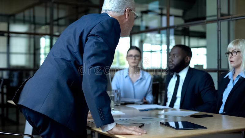 Furious boss mad at company employees, stressful job, lack of business ethics royalty free stock image